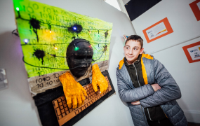 Calvin Ambrose pictured with his artwork, which is part of the exhibition 'Identity' at Mary Immaculate College, Limerick