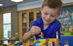 Image of child playing with lego