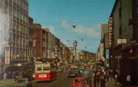 Colour image of a bustling Limerick City in the mid 20th Century