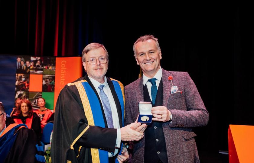 Professor Eugene Wall presents Dáithí Ó Sé with his Alumnus of the Year award