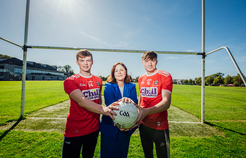 MIC students and Cork U20s All Ireland football winners, Cathail O'Mahony and Sean Meehan pictured with Professor Niamh Hourigan, Vice-President of Academic Affairs, MIC.