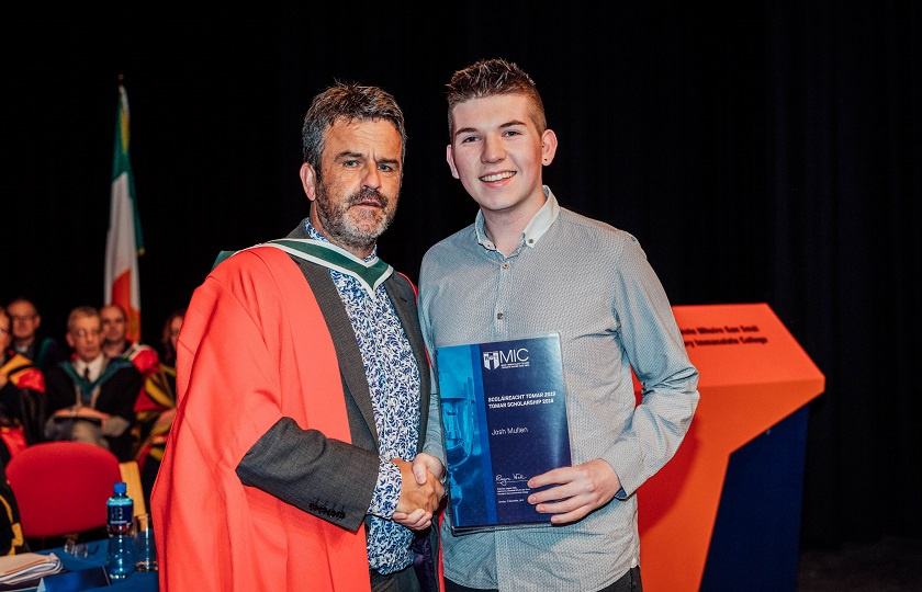 Dr Finn Ó Murchú presenting Josh Mullen with the inaugural TOMAR Trust Path Scholarship