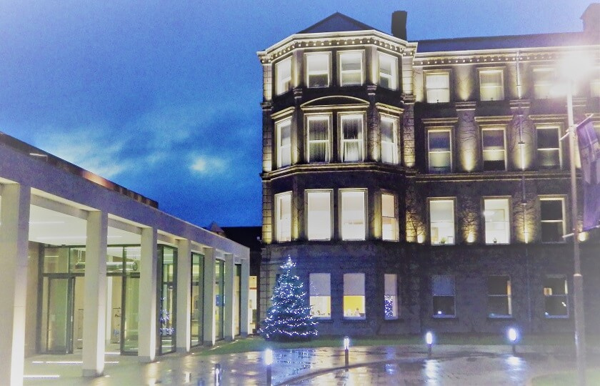 Image of MIC Foundation Building at night with Christmas tree