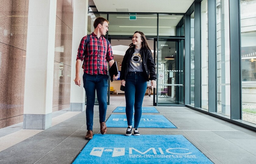 Two Mary Immaculate College students walking out the main entrance to MIC Limerick