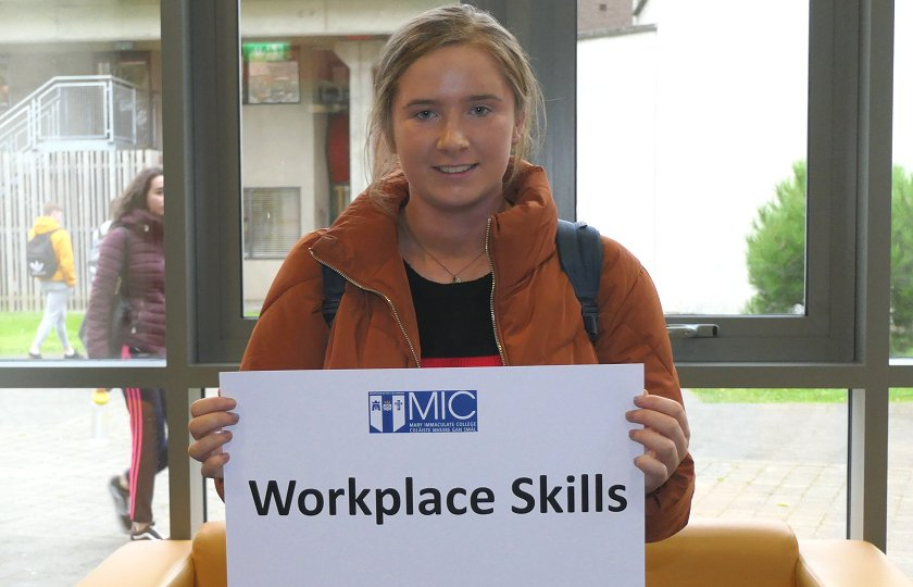 Student pictured at Mary Immaculate College holding a sign saying 'Employability'