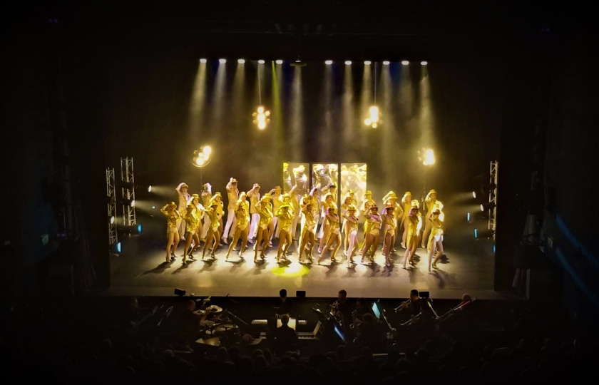 Members of MIDAS, MIC's Dramatic Arts Society, performing 'A Chorus Line' on stage at the Lime Tree Theatre