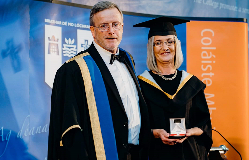 Geraldine Brassil pictured with Professor Eugene Wall, President of MIC