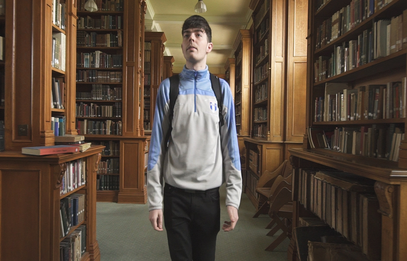 MIC student walking through library